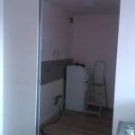 Stavba nové, částečně oddělené kuchyně